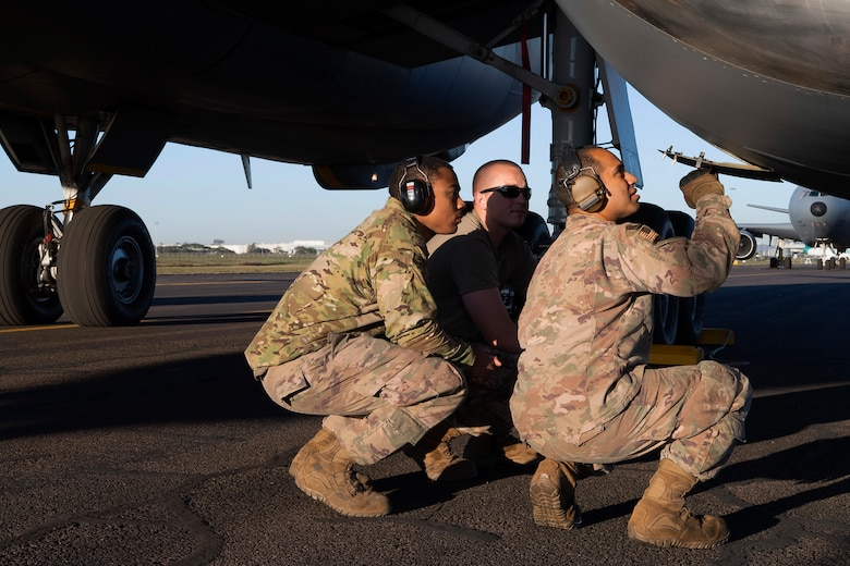 U.S. Airmen with the 605th Air Maintenance Squadron, Joint Base McGuire-Dix-Lakehurst, New Jersey, and the 60th AMXS, Travis Air Force Base, California, inspect a KC-10 Extender engine turbine during pre-flight checks July 16, 2019, at Brisbane International Airport, Australia. The Extender arrived July 12 to support major air operations for USAF, Royal Australian Air Force and U.S. Navy aircraft operating out of RAAF Base Amberley for Exercise Talisman Sabre 19, a biannual joint operation providing effective and intense training to ensure U.S. Forces are combat ready, capable, interoperable, and deployable on short notice.  (U.S. Air Force photo by Senior Airman Elora J. Martinez)