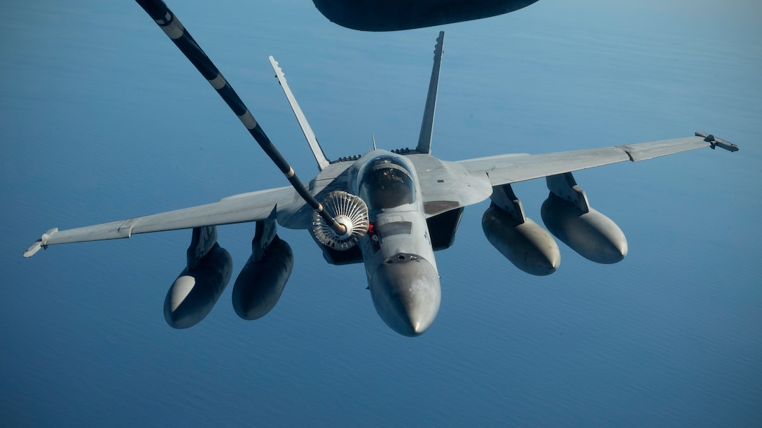 A Royal Australian Air Force F/A-18 Super Hornet is refueled by a U.S. Air Force KC-10 Extender July 17, over the Pacific Ocean near the coast of Brisbane, Australia, in support of Exercise Talisman Sabre 19. The Super Hornet was one of several aircraft used during TS19,  alongside other USAF and RAAF airborne warning and control system aircraft, refuelers, tankers and bombers. TS19 is a month of high end, realistic warfighting training designed to increase U.S. and Australian combat readiness and interoperability for a free and open Indo-Pacific. (U.S. Air Force photo by Senior Airman Elora J. Martinez)
