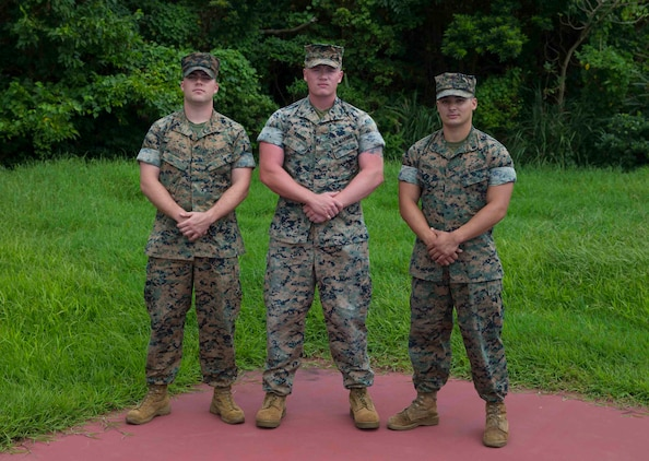 U.S. Marines from Communications Company, Headquarters Battalion, 3rd Marine Division pose for a photo on Camp Courtney, Okinawa, Japan, July 17, 2019. The Marines showed heroic actions on July 14, 2019 at Mermaids Gratto, Okinawa, Japan, by attempting to save swimmers in need. (U.S. Marine Corps Photo by Sgt. Trystan Jordan)