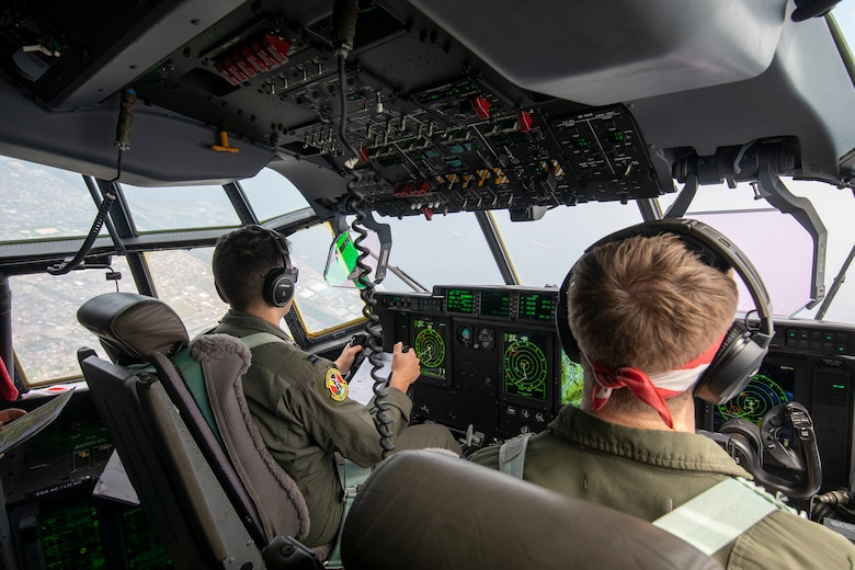 U.S. Air Force Capt. Evan Taylor and Capt. Michael Pyles, 36th Airlift Squadron C-130J pilots