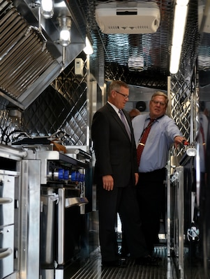 A new food truck purchased by the Defense Logistics Agency Troop Support for the Army's Joint Center of Culinary Excellence stopped at the DLA headquarters in Philadelphia on July 9, 2019. Richard Ellis, left, the deputy commander of Defense Logistics Agency Troop Support, gets a tour of the new Army food truck from Dean Schoendorfer, right, the integrated support team chief within the Subsistence supply chain's Food Equipment branch at DLA Troop Support.