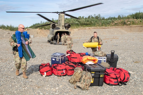 Mississippi Army National Guard Maj. Richmond Lachney and Staff Sgt. Vernon Wasson, 47th Weapons of Mass Destruction-Civil Support Team, unload equipment from an Alaska Army National Guard CH-47 Chinook helicopter during ORCA 2019 in Alaska, July 16.