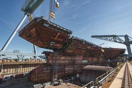 The final piece of the flight deck of the future USS John F. Kennedy (CVN 79) is lifted into place at Huntington Ingalls Industries' Newport News Shipbuilding Division in Newport News, Va., July 10.