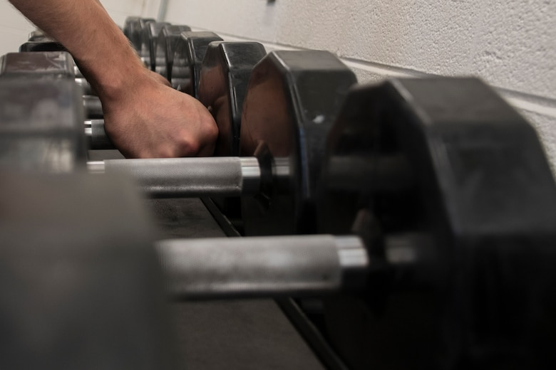 Staff Sgt. Steven Naughton, an Operations Intelligence Analyst at the 179th Airlift Wing, Mansfield, Ohio, exercises in the base gym June 8, 2019. Fitness is recognized as one of the four pillars of Comprehensive Airman Fitness, a concept used in the Air Force to ensure Airmen always remain ready to accomplish the mission. (U.S. Air National Guard photo by Senior Airman Megan Shepherd)