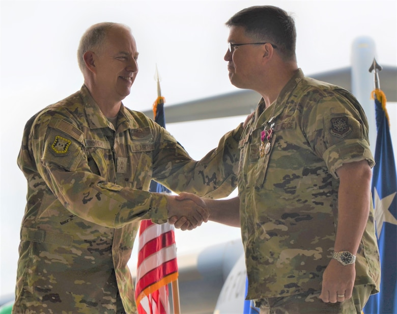 "Col. William ""Percy"" Percival, outgoing 627th Air Base Group commander and Joint Base Lewis-McChord Garrison deputy commander, is awarded the Legion of Merit by Maj. Gen. John Gordy II, U.S. Air Force Expeditionary Center commander, at an awards ceremony at JBLM, July 15."