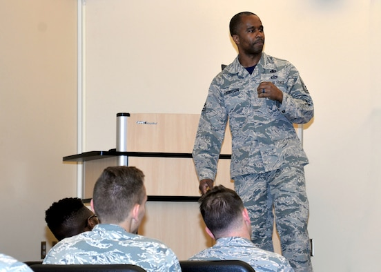 Senior Master Sgt. Anthony Thompson Jr., 55th Force Support Squadron career assistance advisor, speaks with Airmen about ethics at the conclusion of the First Term Airmen's Center course, which is an introductory course for Airmen when they arrive at their first duty station.
