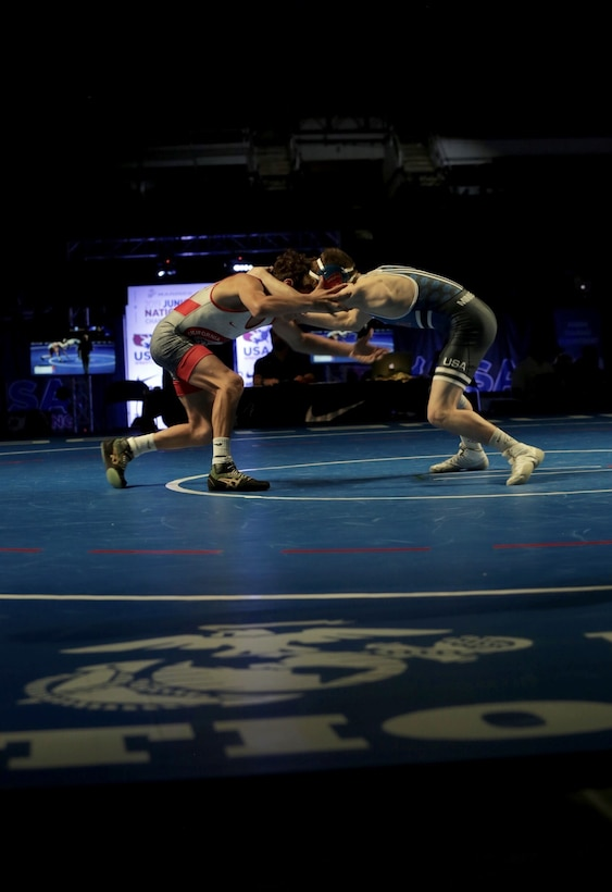 Andre Gonzales, from Team California, wrestles and wins against Blake West, from Team Minnesota, during the US Marine Corps Cadet and Junior National Championships in Fargo, North Dakota, July 16, 2019. USA Wrestling, a representative of the United States Olympic Committee, is the central organization that coordinates amateur wrestling programs throughout the nation.  USA Wrestling is the national governing body for the sport of wrestling and is the central organization that coordinates amateur wrestling programs in the nation and works to create interest and participation in these programs. The Marine Corps began partnering with USAW in 2017 to become intimately involved with the sport of wrestling through event activations, event branding and brand exposure through media. By partnering specifically with USAW, the Marine Corps reaches a broad cross-section of high school and collegiate-aged wrestlers as well as an ever-growing influencer network of coaches, referees, wrestling alumni and parents.