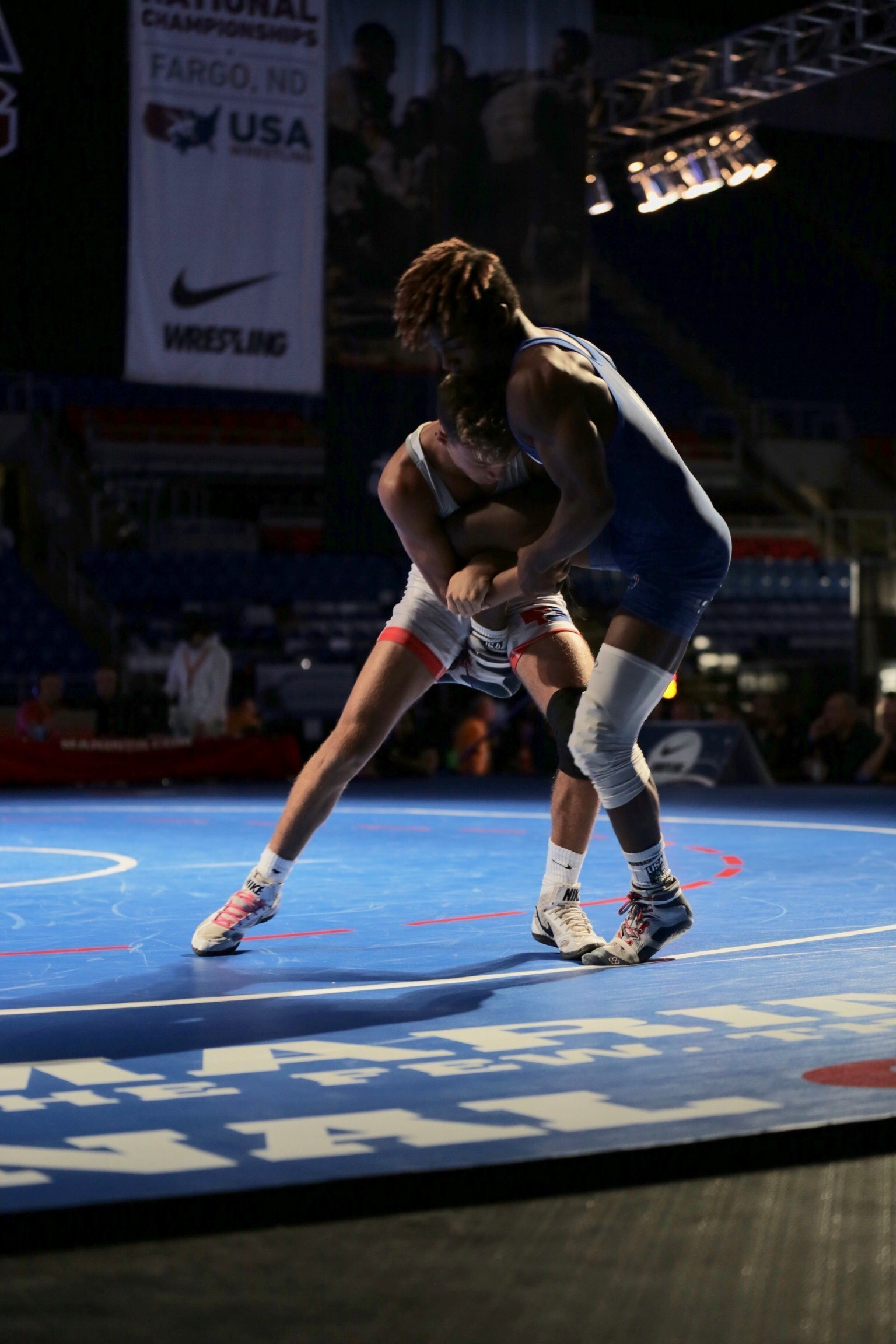 Anthony Molton from Team Illinois wrestles and wins against Jakason Burks from Team Nebraska during the US Marine Corps Cadet and Junior National Championships in Fargo, North Dakota, July 16, 2019. USA Wrestling is the national governing body for the sport of wrestling and is the central organization that coordinates amateur wrestling programs in the nation and works to create interest and participation in these programs. The Marine Corps began partnering with USAW in 2017 to become intimately involved with the sport of wrestling through event activations, event branding and brand exposure through media. By partnering specifically with USAW, the Marine Corps reaches a broad cross-section of high school and collegiate-aged wrestlers as well as an ever-growing influencer network of coaches, referees, wrestling alumni and parents.