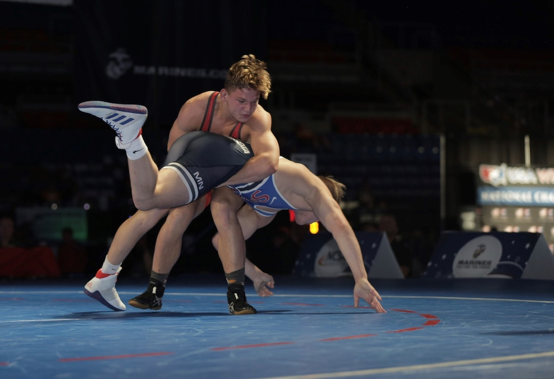 Gavin Nelson from Team Minnesota wrestles and wins against Tate Picklo from Team Oklahoma during the US Marine Corps Cadet and Junior National Championships in Fargo, North Dakota, July 18, 2019. USA Wrestling is the national governing body for the sport of wrestling and is the central organization that coordinates amateur wrestling programs in the nation and works to create interest and participation in these programs. The Marine Corps began partnering with USAW in 2017 to become intimately involved with the sport of wrestling through event activations, event branding and brand exposure through media. By partnering specifically with USAW, the Marine Corps reaches a broad cross-section of high school and collegiate-aged wrestlers as well as an ever-growing influencer network of coaches, referees, wrestling alumni and parents.