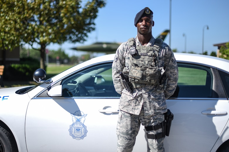 Airman 1st Class Desman Martin, 22nd Security Forces patrolman, poses for a photo July 15, 2019, at McConnell Air Force Base, Kan. Martin joined the Air Force April 3, 2018, and went on to complete security forces' technical school. This year, Martin was selected to attend the Phoenix Raven Qualification Course for specially qualified security forces Airmen in September 2019. (U.S. Air Force photo by Airman 1st Class Alexi Myrick)