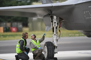 F-35A Lightning II aircraft conduct hot pit refueling at RAF Marham, England.