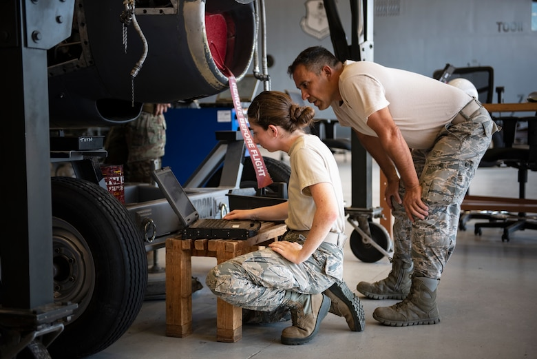 Airman 1st Class Rylee Johnson, left, and Senior Airman Enrique Yanez, 361st Training Squadron aerospace propulsion apprentice course students, look at their training objectives at Sheppard Air Force Base, Texas, July 18, 2019. Johnson and Yanez's objective for this day is to remove and re-install a T-56 turboprop engine's reduction gearbox, which helps the engine reduce the RPM to accommodate a propeller. (U.S. Air Force photo by Airman 1st Class Pedro Tenorio)