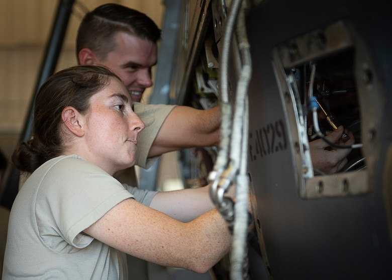 Airman 1st Class Rylee Johnson, front, and Airman 1st Class Jeremy Barnes, 361st Training Squadron aerospace apprentice course students, work on a T-56 turboprop engine at Sheppard Air Force Base, Texas, July 18, 2019. Barnes and Johnson are removing and re-installing a reduction gearbox. The gearbox reduces the engines RPM from 13820 to 1020, as the engine is a jet engine modified to have a propeller attached. (U.S. Air Force photo by Airman 1st Class Pedro Tenorio)