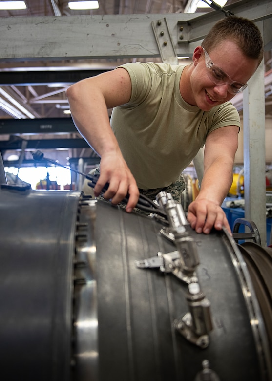 Airman 1st Class Jeremiah Butler, 361st Training Squadron aerospace propulsion apprentice course student, removes safety wires from a F110 turbine engine at Sheppard Air Force Base, Texas, July 18, 2019. Butler is a native of St. Louis, Missouri and is attending technical training school at Sheppard AFB. In this block of training he is learning to remove and re-install the fuel nozzle section of the engine. The students complete these tasks over and over as it helps them understand the engine as well as teaches them to identify faults and discrepancies during an inspection. (U.S. Air Force photo by Airman 1st Class Pedro Tenorio)