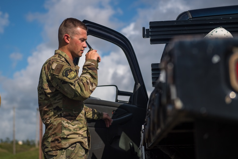 U.S. Air Force Airman 1st Class Thomas Knight, 325th Maintenance Squadron stockpile surveillance crew chief, talks into the walkie-talkie at Tyndall Air Force Base, Florida, July 17, 2019.