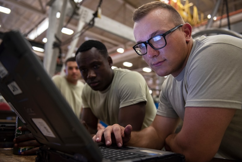 From right, Airman Michael Chepel, Airman 1st Class Ethan Gray and Airman 1st Class Matthew Stewart, 361st Training Squadron apprentice course students, look at their training objectives at Sheppard Air Force Base, Texas, July 18, 2019. Sheppard AFB is one of the largest training bases the Air Force has, and with so many Airmen going in and out it allows Americans from all around the states to work together for one mission and build comradery. You could see that in the picture as Chepel is from Graham, Washington, Gray is from Atlanta, Georgia, and Stewart is from Mansfield, Texas. (U.S. Air Force photo by Airman 1st Class Pedro Tenorio)