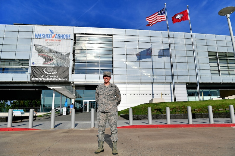 An Airman stand in front of the library she will be interlining at.