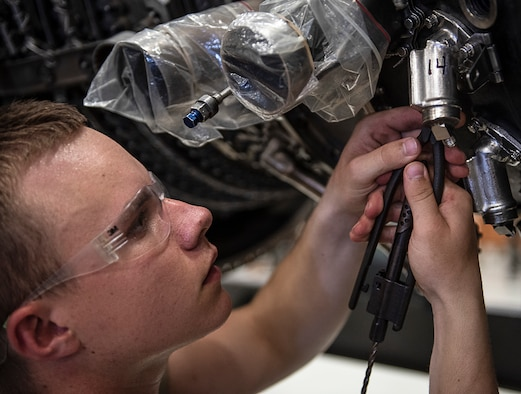 Airman 1st Class Jeremiah Butler, 361st Training Squadron aerospace propulsion apprentice course student, removes safety wires from an F110 turbine engine at Sheppard Air Force Base, Texas, July 18, 2019. Butler is a native from St. Louis, Missouri, and is now attending technical training at Sheppard. In this block he learns how to remove and re-install the fuel nozzle section of the engine. (U.S. Air Force photo by Airman 1st Class Pedro Tenorio)