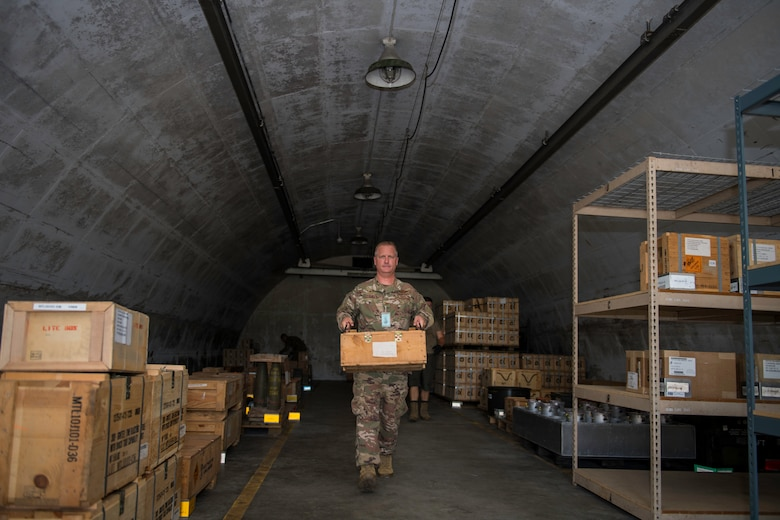 U.S. Air Force Col. Brian Laidlaw, 325th Fighter Wing commander, carries a box of munitions at Tyndall Air Force Base, Florida, July 17, 2019.