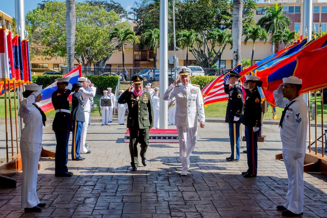 Men salute during ceremonial arrival.