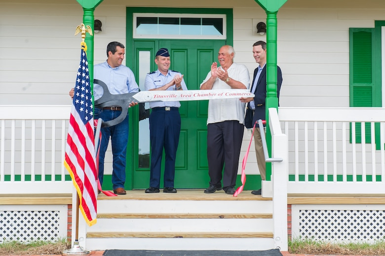 Brig. Gen. Douglas A. Schiess, 45th Space Wing Commander, assists in cutting the ribbon on the new Cape Canaveral Light House Keeper's Cottage and Museum at Cape Canaveral Air Force Station, Fla., July 18, 2019. The ceremony celebrated the opening of the First Keepers' Cottage that will display artifacts and house interactive exhibits.