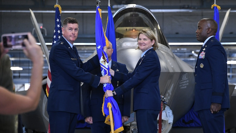 Lt. Gen. Donald Kirkland, Air Force Sustainment Center commander, passes the guidon to Brig. Gen. C. McCauley von Hoffman, incoming Ogden Air Logistics Complex commander, during a change of command ceremony July 19, 2019, at Hill Air Force Base, Utah.