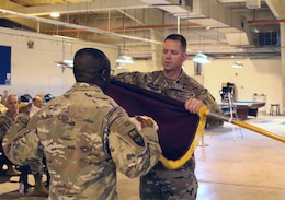 Col. Jeffrey McCarter, 8th Medical Brigade commander, cases the colors with Command Sgt. Maj. Ekondua Amoke during a transfer of authority ceremony with the 3d Medical Command Deployment Support -  Forward at Camp As Sayliyah, Qatar, July 18, 2019.