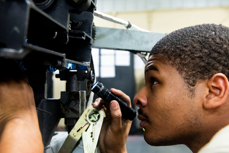 Senior Airman James Jennings, 23d Maintenance Squadron armament (ARMs) flight gun element member, performs an inspection on a 30mm GAU-8 gatling gun system, July 17, 2019, at Moody Air Force Base, Ga. The ARMs shop primarily performs quality armament systems maintenance and inspections to provide aircrews with safe and reliable weapon systems for lethal airpower employment. (U.S. Air Force photo by Senior Airman Erick Requadt)