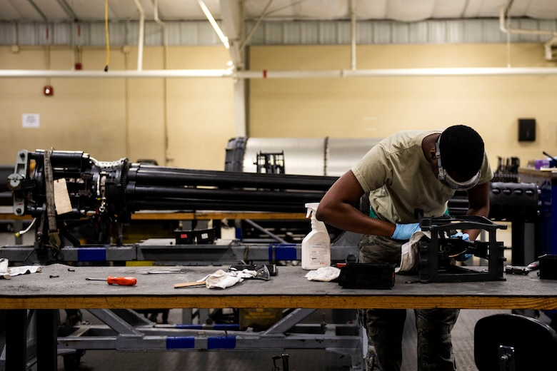 Senior Airman Deion Neal, 23d Maintenance Squadron armament (ARMs) flight gun element member, cleans a tension equalizer, July 17, 2019, at Moody Air Force Base, Ga. The ARMs shop cleans the components used for the various weapon systems and removes any corrosion to ensure their continued longevity and effectiveness. (U.S. Air Force photo by Senior Airman Erick Requadt)