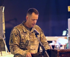 Col. Jeffrey McCarter, 8th Medical Brigade commander, speaks during a transfer of authority ceremony between 8th Medical Brigade and 3rd Medical Command Deployment Support - Forward at Camp As Sayliyah, Qatar.