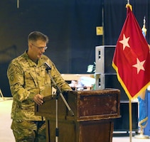 Col. Richard Bailey, 3d Medical Command Deployment Support - Forward commander, speaks during a transfer of authority ceremony with the 8th Medical Brigade at Camp As Sayliyah, Qatar.