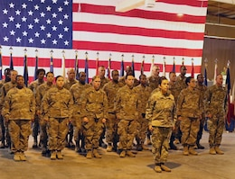 Soldiers of 8th Medical Brigade stand in formation during a transfer of authority ceremony between 8th Med and 3rd Medical Command Deployment Support - Forward at Camp As Sayliyah, Qatar, July 18, 2019.