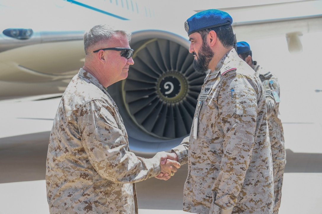 U.S. Marine Corps Gen. Kenneth F. McKenzie Jr., the commander of U.S. Central Command, left, shakes hands with Maj. Gen. Khaled Al-Shablan, the instillation commander of Prince Sultan Air Base, July 18, 2019. While visiting the Central region, McKenzie met with forward deployed troops and key allied leaders and reaffirmed the U.S. commitment to security and stability in the region. (U.S. Marine Corps photo by Sgt. Roderick Jacquote)