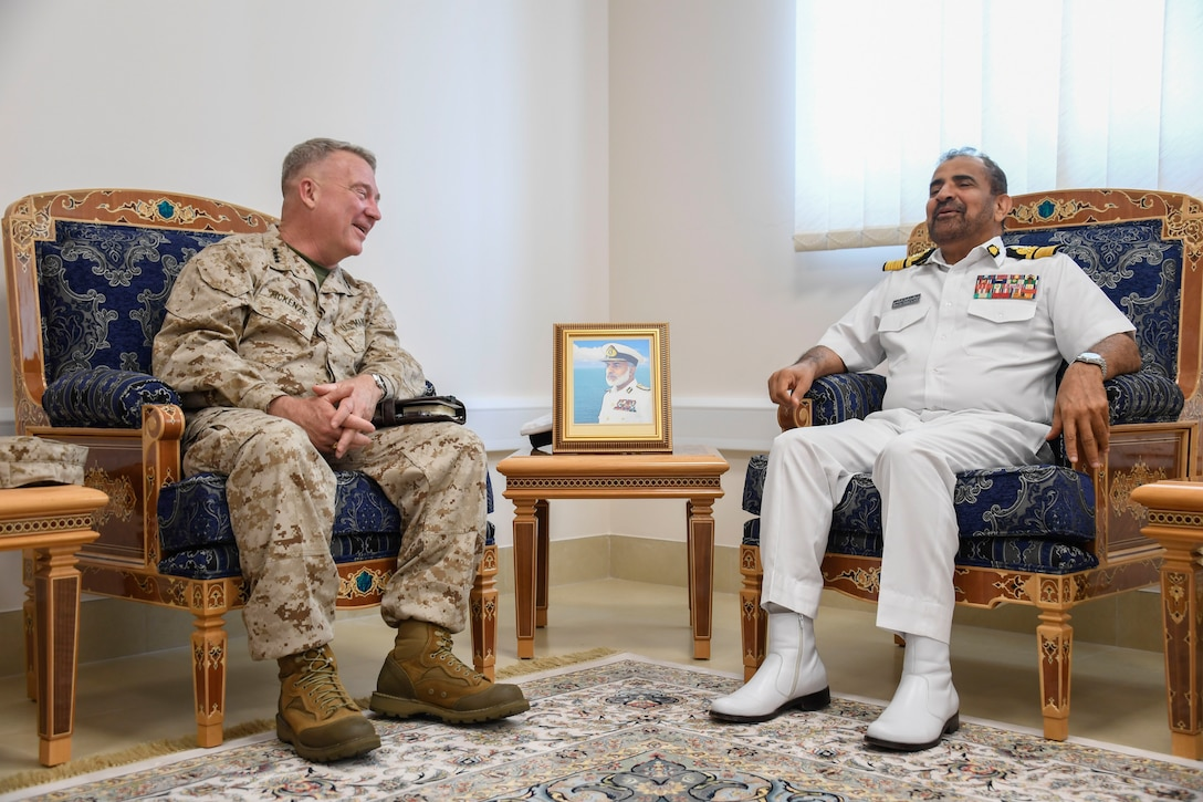 U.S. Marine Corps Gen. Kenneth F. McKenzie Jr., the commander of U.S. Central Command, left, speaks with Rear Adm. Abdullah bin Khamis bin Abdullah Al-Raisi, the commander of Royal Navy Oman, on Muaskar Al Murtafa Base, July 17, 2019. While visiting the Central region, McKenzie met with forward deployed troops and key allied leaders and reaffirmed the U.S. commitment to security and stability in the region. (U.S. Marine Corps photo by Sgt. Roderick Jacquote)