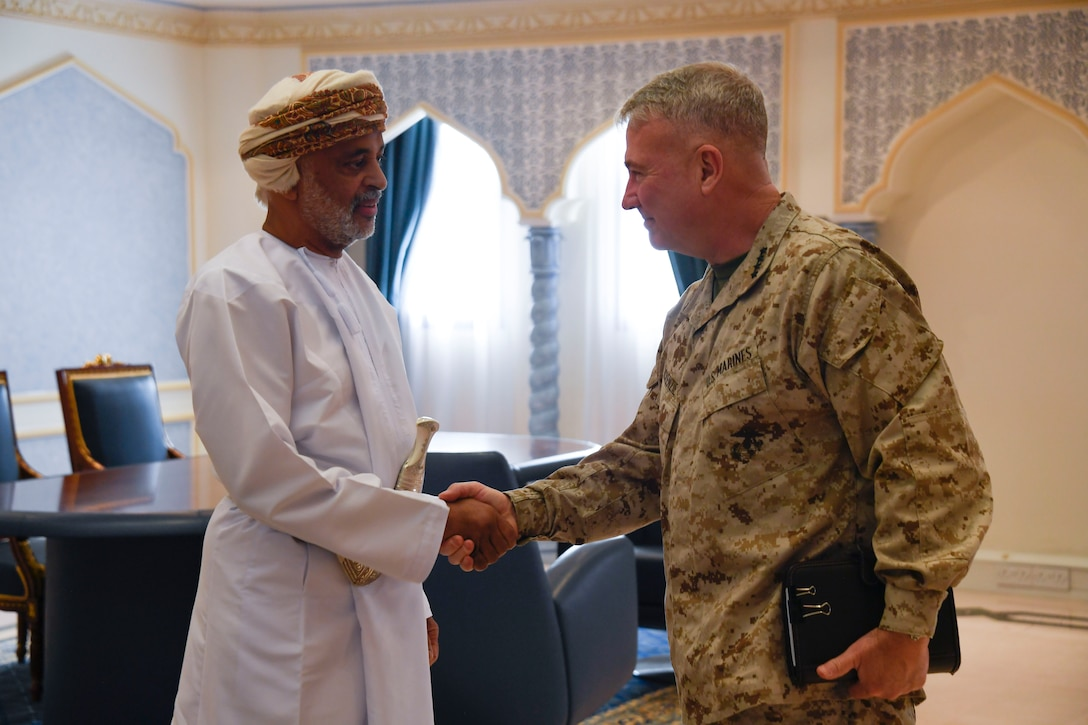 U.S. Marine Corps Gen. Kenneth F. McKenzie Jr., the commander of U.S. Central Command, right, shakes hands with His Excellency Mohammed Al Rasbi, Secretary General of the Ministry of Defense of Oman, on Muaskar Al Murtafa Base, July 17, 2019. While visiting the Central region, McKenzie met with forward deployed troops and key allied leaders and reaffirmed the U.S. commitment to security and stability in the region. (U.S. Marine Corps photo by Sgt. Roderick Jacquote)