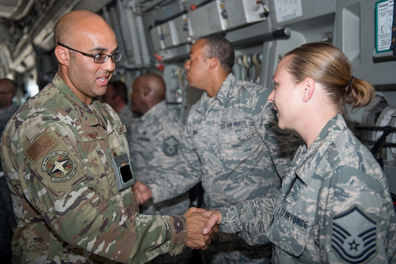 Maj. Jason Lowrey, 712th Aircraft Maintenance Squadron operations officer, congratulates Master Sgt. Brinnae Wigley, 712th AMXS crew chief, during a dedicated crew chief ceremony at Dover Air Force Base, Delaware, July 13, 2019. Wigley was recognized as the DCC for the C-17 Globemaster III serial number 06-6168. (U.S. Air Force photo by Staff Sgt. Damien Taylor)