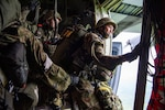 A Japan Ground Self-Defense Force soldier assigned to the 1st Airborne Brigade is ready to jump from a U.S. Air Force C-130J Super Hercules from the 36th Airlift Squadron over Hiju-dai exercise area, Oita prefecture, Japan, July 16, 2019. The training allows USAF and JGSDF units to work alongside each other while improving the readiness of our armed forces.