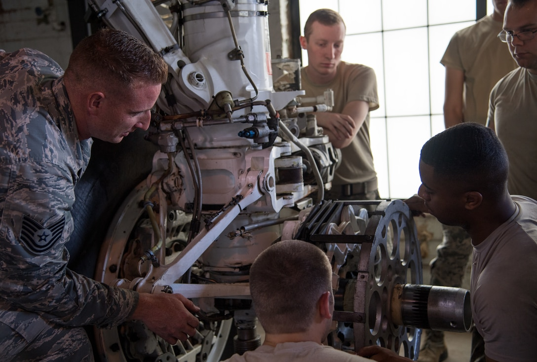 Tech. Sgt. Dylan Drake (left), 372nd Training Squadron Field Training Detachment 5 crew chief instructor, speaks to his students during a course at Barksdale Air Force Base, Louisiana, June 4, 2019. After maintainers graduate Basic Military Training they arrive at their technical school to learn the fundamental parts of their jobs. Once they receive their base assignment they then are trained at an FTD, like Barksdale's, to learn specifics for their aircraft. (U.S. Air Force photo by Senior Airman Tessa B. Corrick