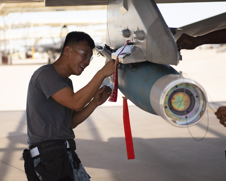 ME-2 Teo Choh Hwai, 425th Aircraft Maintenance Unit load crew member, prepares an F-16 Fighting Falcon for munition loading at July 18, 2019, at Luke Air Force Base, Ariz.