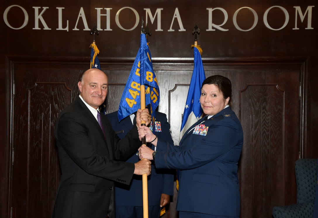 Col. Michelle Hall accepted command of the 848th Supply Chain Management Group in a ceremony in the Oklahoma Room of Bldg. 3001 July 11. Dennis D'Angelo, director of the 448th Supply Chain Management Wing, presided over the ceremony in which Col. Robert Kielty relinquished command of the group. Hall will command four squadrons with over 700 personnel who provide sustainment of 32 major weapon systems and over 12,000 engines. (U.S. Air Force photo/Kelly White)