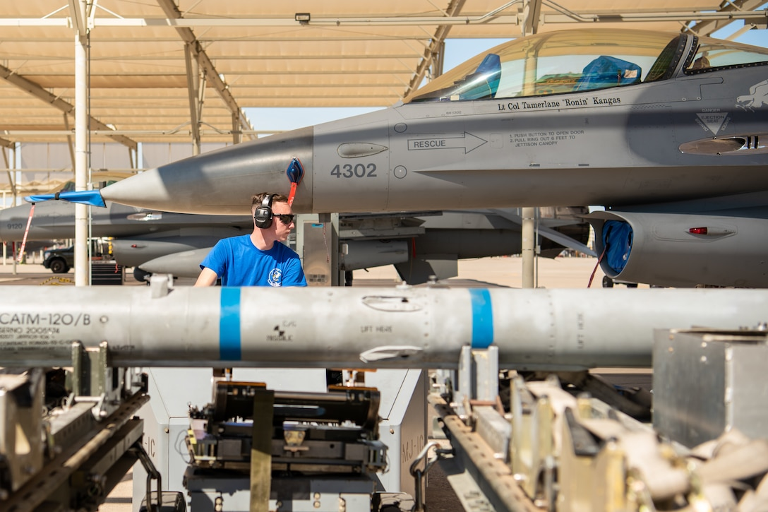 Airman 1st Class Ryan Elmer, 309th Aircraft Maintenance Unit load crew member, drives a jammer during the 2nd Quarter Load Crew Competition, July 18, 2019 at Luke Air Force Base, Ariz.