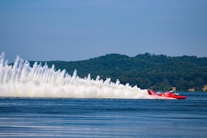 A hydroplane speeds across the water at Lake Guntersville during Hydrofest in Guntersville, Alabama June 28, 2019. (U.S. Air National Guard photo)