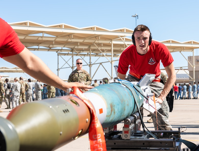 Airman 1st Class Calvin Henderson, 62nd Aircraft Maintenance Unit weapons load crew member, works with his team to prepare an inert bomb to be loaded onto an F-35A Lighting II July 18, 2019, at Luke Air Force Base, Ariz.