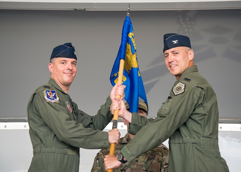 Col. Daniel Walls, left, 23d Wing commander, presents the guidon to Col. Ryan Haden, right, 23d Fighter Group (FG) commander,  as he assumes command during the 23d FG change of command ceremony, July 19, 2019, at Moody Air Force Base, Ga. The 23d FG is the Air Force's largest A-10C Thunderbolt II fighter group that consists of two combat ready A-10C squadrons and an operation support squadron.  Haden previously served as the J5/8 plans division, Eastern Flank Branch Chief, United States European Command, Germany. Haden is no stranger to the 23d FG as he previously commanded the 74th Fighter Squadron and served as deputy commander for the 23d FG. (U.S. Air Force photo by Airman 1st Class Eugene Oliver)