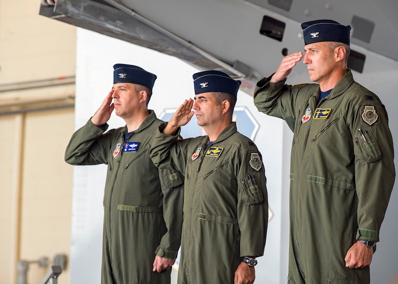 Wing leadership render salutes for the playing of the national anthem during a change of command ceremony, July 19, 2019, at Moody Air Force Base, Ga. The ceremony is a military tradition that represents a formal transfer of unit's authority and responsibility from one commander to another. (U.S. Air Force photo by Airman 1st Class Eugene Oliver)