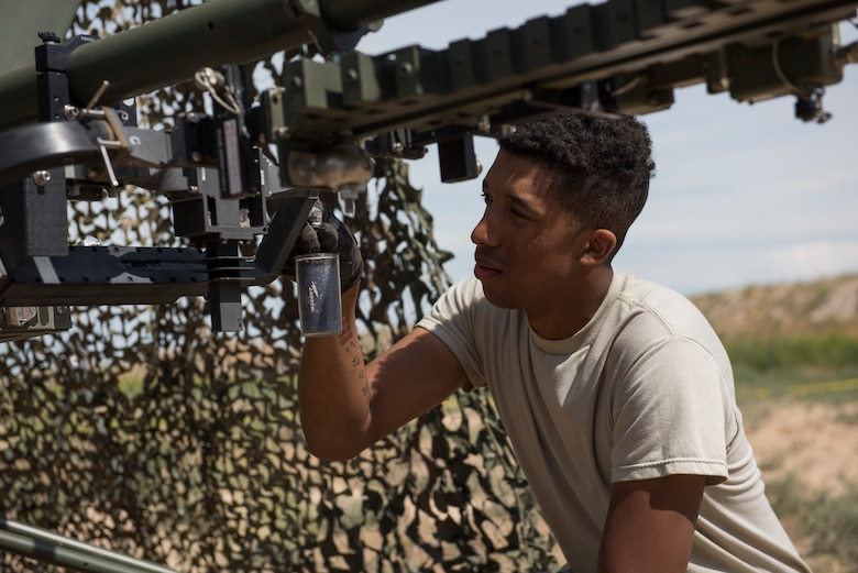 U.S. Air Force Airman 1st Class Miles Swammi, 726th ACS radar systems technician, affixes a filter onto a Ground Mulitband Terminal (GMT) during a 726th Air Control Squadron Hardrock Exercise 19-2 July 16th, 2019, at Mountain Home Air Force Base, Idaho. The filter helps to soak water from the internel gear of the GMT. (U.S. Air Force photo by Senior Airman Tyrell Hall)