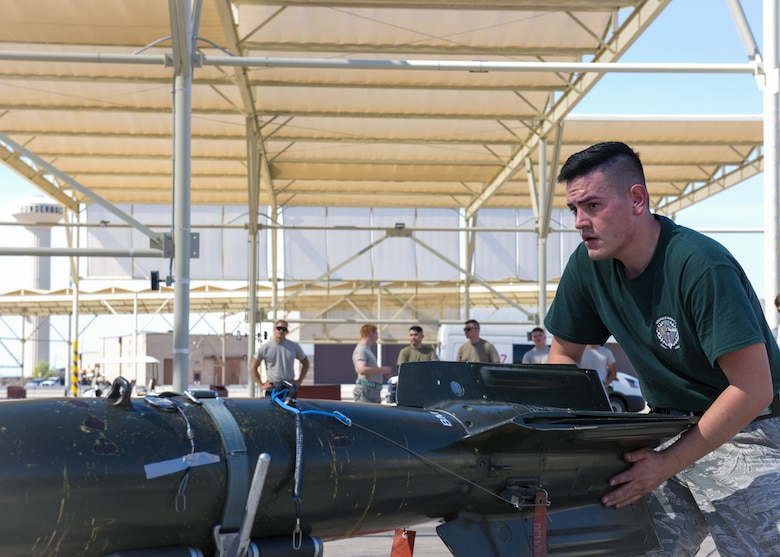 Airman 1st Class Nathan Martinez, 308th Aircraft Maintenance Unit weapons load crew member, prepares to load an inert bomb onto an F-35A Lightning II during the 2nd Quarter Load Crew Competition July 18, 2019, at Luke Air Force Base, Ariz.