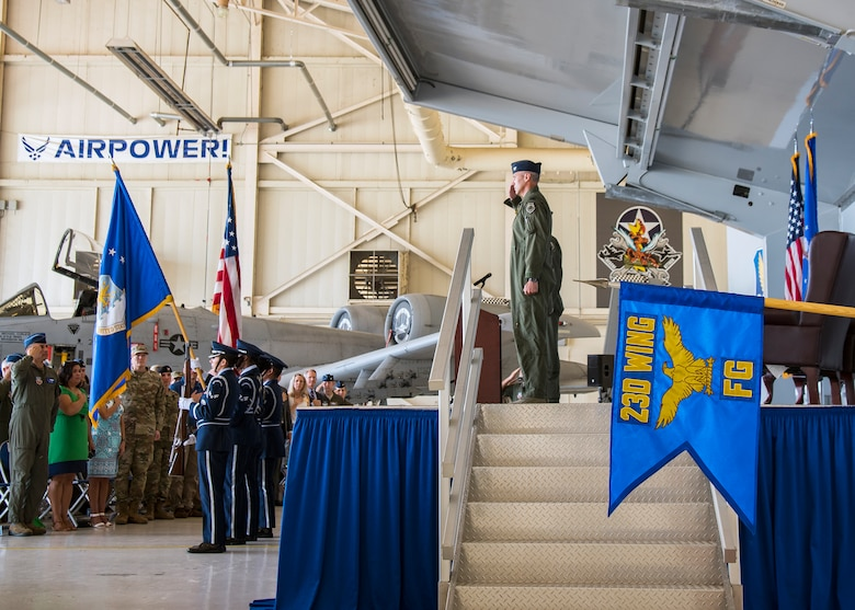 Airmen render salutes during a change of command ceremony, July 19, 2019, at Moody Air Force Base, Ga. The 23d Fighter Group is the Air Force's largest A-10C Thunderbolt II fighter group that consists of two combat ready A-10C squadrons and an operation support squadron.   The ceremony is a military tradition that represents a formal transfer of unit's authority and responsibility from one commander to another. (U.S. Air Force photo by Airman 1st Class Eugene Oliver)