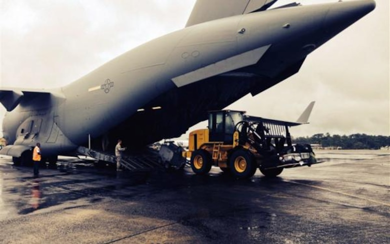 Team McChord Airmen unload a C-17 Globemaster III in Liberia, October 8, 2014. The Airmen assisted during an ebola outbreak in West Africa.