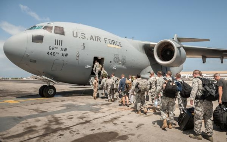 Marines, Airmen and soldiers board a C-17 Globemaster III at Leopold Sedar Senghor International Airport, Senegal, on October 19, 2014, bound for Monrovia, Liberia.
